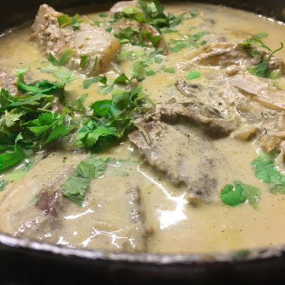 Lamb braised in milk with garlic & fennel